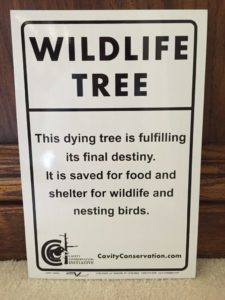 Put our sign on a dead tree
